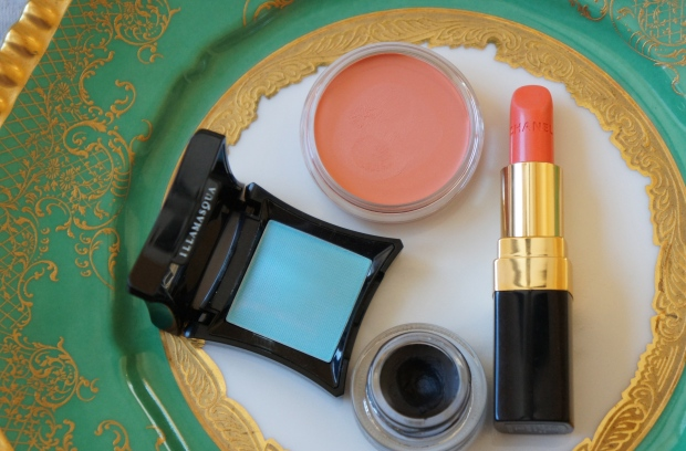 Clockwise from the top: Revlon cream blush in Pinched; Chanel Rouge Coco in Sari Doré (pre-reformulation); MAC Fluidline in Blacktrack; Illamasqua eyeshadow single in Anja.