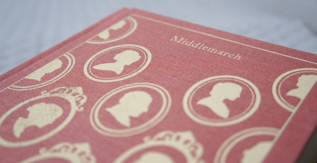 Ivory silhouettes on a rosy background: Like a cameo pin in book form.