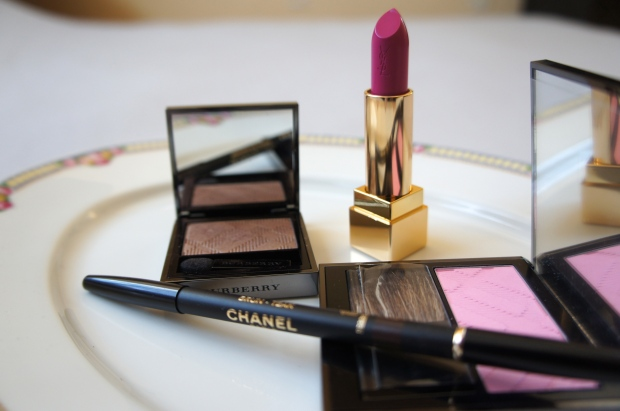 From the left, Burberry eyeshadow single in Pale Barley; YSL Rouge Pur Couture lipstick 19 IFuchsia); Burberry blusher in Peony; Chanel Le Crayon Yeux in Brun Teak (foreground).