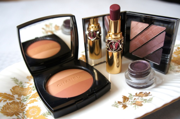 Plum for evening. From the left, Chanel Les Beiges Multicolor in shade 2; YSL Rouge Volupté Shine in Prune in Fire; Burberry eyeshadow quad in Nude blush (background); Maybelline gel liner in Aubergine.