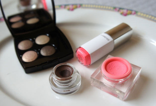 From the left: Chanel Tissé Mademoiselle eyeshadow quad; Maybelline gel liner in brown; Laneige Water Tint in Neon Pink; YSL cream blush no. 9.