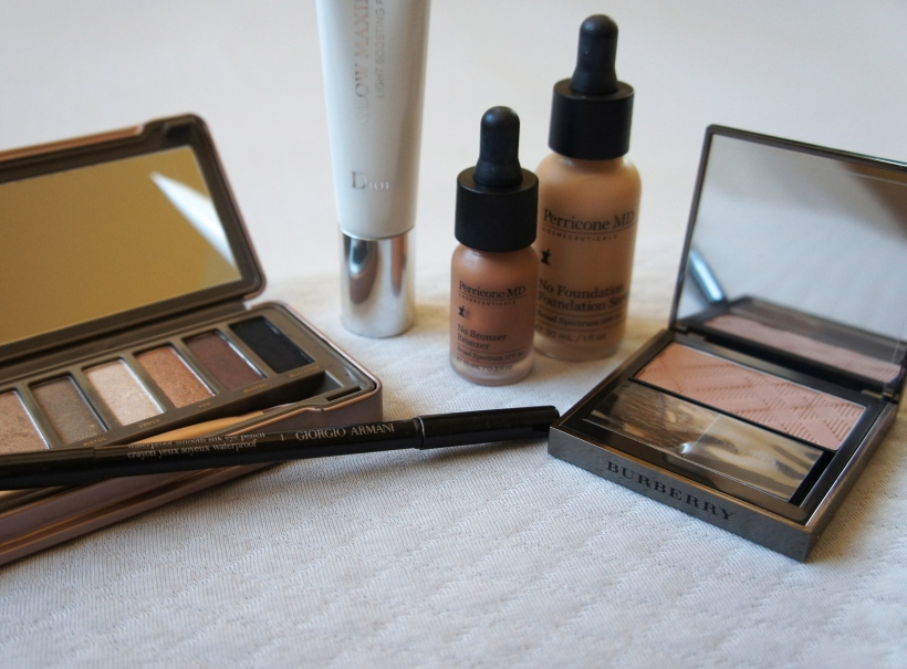 From the left: Blackout eyeshadow from the Urban Decay Naked 2 palette; Dior Glow Maximizer Primer; Perricone MD No Bronzer Bronzer; Perricone MD No Foundation Foundation Serum; Burberry blush in Earthy; Armani gel eye pencil in black (foreground).